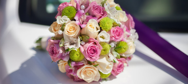 Beautiful wedding bouquet of fresh pink roses bridal flowers